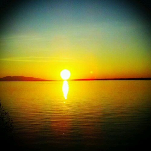 The setting sun.